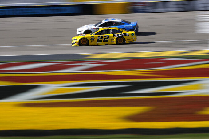 Joey Logano (22) drives during a NASCAR Cup Series auto race at Las Vegas Motor Speedway, Sunday, March 3, 2019, in Las Vegas. (AP Photo/John Locher)