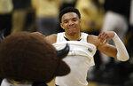 Colorado guard Tyler Bey celebrates after an NCAA college basketball game against California, Thursday, Feb. 6, 2020, in Boulder, Colo. (AP Photo/David Zalubowski)