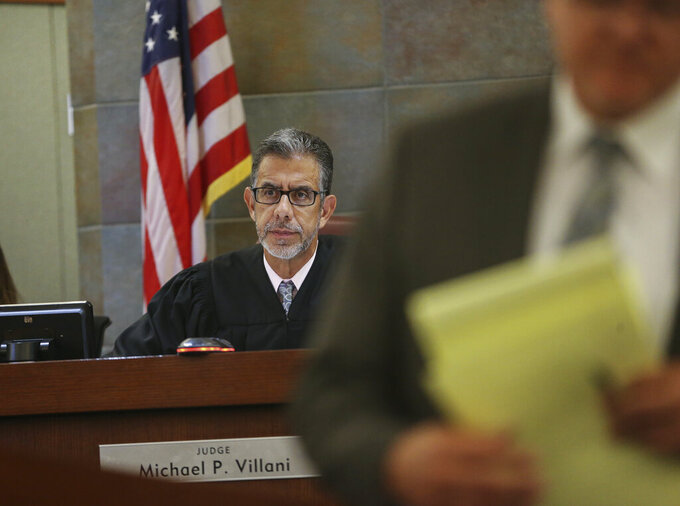 FILE - In this June 18, 2019, file photo, U.S. District Judge Michael Villani, center, listens in the State of Nevada case at the Regional Justice Center in Las Vegas. A day after Nevada Gov. Steve Sisolak and the top Democrat in the Legislature declared efforts to repeal the state's death penalty law dead, Villani on Monday, May 10, 2021, pushed back to June 4 a hearing on the district attorney's request to set a late July date for the lethal injection of Zane Michael Floyd. Floyd, 45, would be the first convicted killer put to death in Nevada since 2006. (Erik Verduzco/Las Vegas Review-Journal via AP, File)