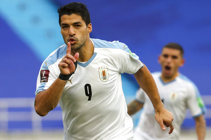 Uruguay's Luis Suarez celebrates after scoring from the penalty spot his side's second goal against Colombia during a qualifying soccer match for the FIFA World Cup Qatar 2022 at the Metropolitano stadium in Barranquilla, Colombia, Friday, Nov. 13, 2020. (AP Photo/Fernando Vergara)