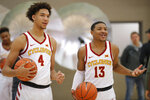 Iowa State forward George Conditt IV, left, and guard Prentiss Nixon laugh with teammates during Iowa State's NCAA college basketball media day, Thursday, Oct. 11, 2018, in Ames, Iowa. (AP Photo/Charlie Neibergall)