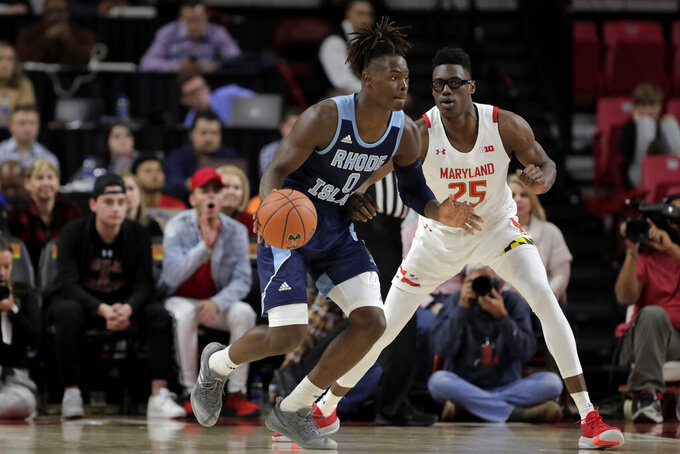 Rhode Island forward Jermaine Harris (0) dribbles against Maryland forward Jalen Smith (25) during the first half of an NCAA college basketball game, Saturday, Nov. 9, 2019, in College Park, Md. (AP Photo/Julio Cortez)