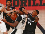 San Antonio Spurs forward Rudy Gay (22) tries to control the ball in front of Sacramento Kings guard DaQuan Jeffries (19) in the second half of an NBA basketball game Friday, July 31, 2020, in Lake Buena Vista, Fla. (Kim Klement/Pool Photo via AP)