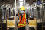 A contractor uses an electrostatic sprayer to disinfect subway cars at the 96th Street station to control the spread of COVID-19, Thursday, July 2, 2020, in New York. Mass transit systems around the world have taken unprecedented — and expensive — steps to curb the spread of the coronavirus, including shutting down New York subways overnight and testing powerful ultraviolet lamps to disinfect seats, poles and floors. (AP Photo/John Minchillo)