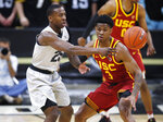 Colorado guard McKinley Wright IV, left, passes the ball as Southern California guard Elijah Weaver defends in the first half of an NCAA college basketball game Saturday, March 9, 2019, in Boulder, Colo. (AP Photo/David Zalubowski)