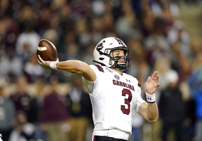 South Carolina quarterback Ryan Hilinski (3) throws a pass against Texas A&M during the first quarter of an NCAA college football game Saturday, Nov. 16, 2019, in College Station, Texas. (AP Photo/David J. Phillip)