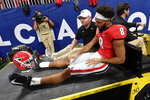 Georgia wide receiver Dominick Blaylock (8) is taken out of the game due to injury against LSU during the first half of the Southeastern Conference championship NCAA college football game, Saturday, Dec. 7, 2019, in Atlanta. (AP Photo/John Amis)