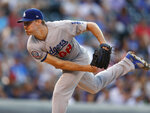 Los Angeles Dodgers starting pitcher Ross Stripling works against the Colorado Rockies in the first inning of a baseball game Thursday, Aug. 9, 2018, in Denver. (AP Photo/David Zalubowski)