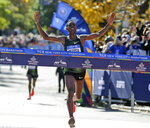 FILE - In this Nov. 4, 2018, file photo, Lelisa Desisa, of Ethiopia, crosses the finish line first in the men's division of the New York City Marathon. The New York City Marathon scheduled for Nov. 1, 2020, has been cancelled because of the coronavirus pandemic.  New York Road Runners announced the cancellation of the world's largest marathon Wednesday, June 24, 2020, after coordinating with the mayor's office and deciding the race posed too many health and safety concerns for runners, volunteers, spectators and others. (AP Photo/Seth Wenig, FIle)