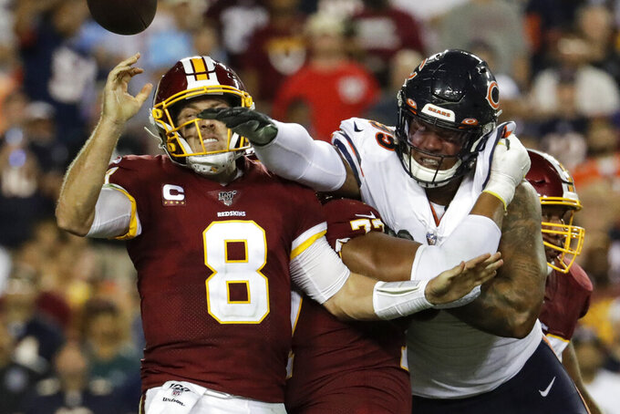 Chicago Bears outside linebacker Khalil Mack (52) hits Washington Redskins quarterback Case Keenum (8) to cause a fumble during the first half of an NFL football game Monday, Sept. 23, 2019, in Landover, Md. (AP Photo/Julio Cortez)