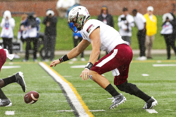 Troy quarterback Kaleb Barker fumbles the snap during the first half of an NCAA college football game against Missouri Saturday, Oct. 5, 2019, in Columbia, Mo. Barker recovered the ball. (AP Photo/L.G. Patterson)