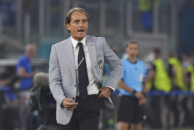 Italy's manager Roberto Mancini shouts out from the touchline during the Euro 2020 soccer championship group A match between Italy and Turkey at the Olympic stadium in Rome, Friday, June 11, 2021. (Alberto Lingria/Pool Photo via AP)