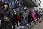 In this Feb. 5, 2020, photo, citizens line up to buy face masks in Hong Kong. The city's often-tumultuous street protests had already slowed in the past two months. Now they have ground to an almost complete halt as attention focuses on how to avoid a recurrence of the SARS pandemic, which killed about 300 people in Hong Kong in 2002-03.(AP Photo/Vincent Yu)