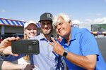 Entertainer Jay Leno smiles for a  photo with fans at a NASCAR Cup Series auto race at Charlotte Motor Speedway in Concord, N.C., Sunday, May 30, 2021. Leno will be giving the command for drivers to start their engines. (AP Photo/Nell Redmond)