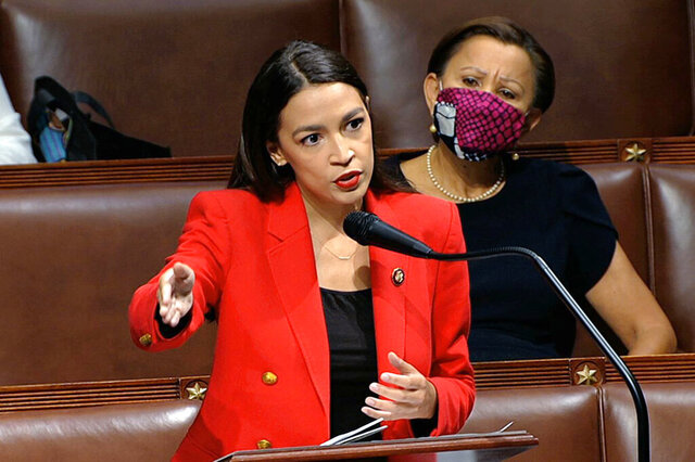 "In this image from video, Rep. Alexandria Ocasio-Cortez, D-N.Y., speaks on the House floor, Thursday, July 23, 2020 on Capitol Hill in Washington.   Ocasio-Cortez's objections to a Republican lawmaker's verbal assault on her expanded Thursday as she and other Democrats took to the House floor to demand an end to a sexist culture of ""accepting violence and violent language against women.""  Rep. Nydia Velázquez, D-N.Y., is seated right. (House Television via AP)"