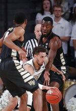 Georgia Tech guard Jose Alvarado (10) drives between Wake Forest forward Ikenna Smart (35), right and guard Torry Johnson (4) during the first half of an NCAA college basketball game, Saturday, Jan. 5, 2019, in Atlanta. (AP Photo/John Bazemore)