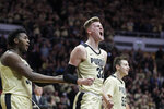 Purdue center Matt Haarms (32) celebrates with forward Trevion Williams (50) and guard Sasha Stefanovic (55) during the first half of an NCAA college basketball game against Michigan State in West Lafayette, Ind., Sunday, Jan. 27, 2019. (AP Photo/Michael Conroy)
