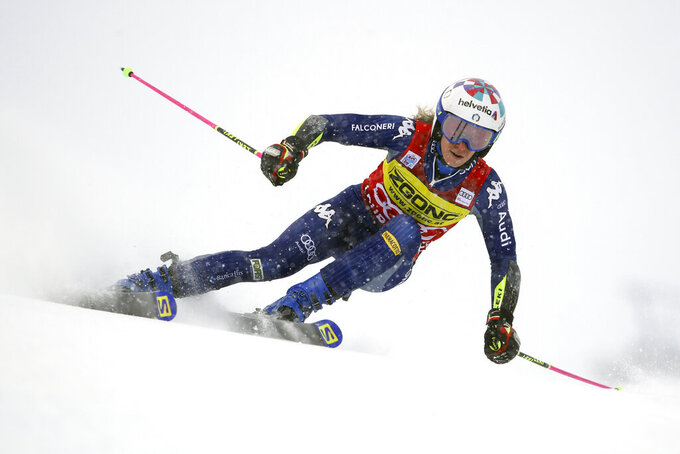 Italy's Marta Bassino speeds down the course during an alpine ski, women's World Cup giant slalom in Courchevel, France, Saturday, Dec. 12, 2020. (AP Photo/Marco Trovati)