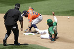 Oakland Athletics' Marcus Semien, right, slides in to steal second base as Houston Astros' Jose Altuve (27) misses the ball in the sixth inning of a baseball game Saturday, Aug. 8, 2020, in Oakland, Calif. (AP Photo/Ben Margot)