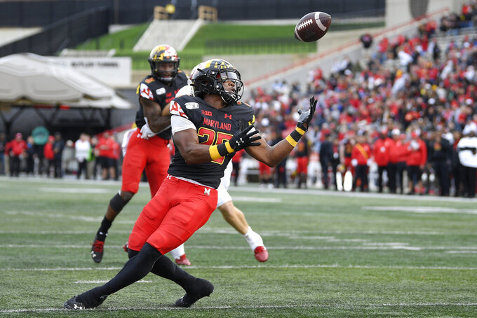 Maryland defensive back Antoine Brooks Jr. (25) makes an interception during the first half of an NCAA college football game against Indiana, Saturday, Oct. 19, 2019, in College Park, Md. (AP Photo/Nick Wass)