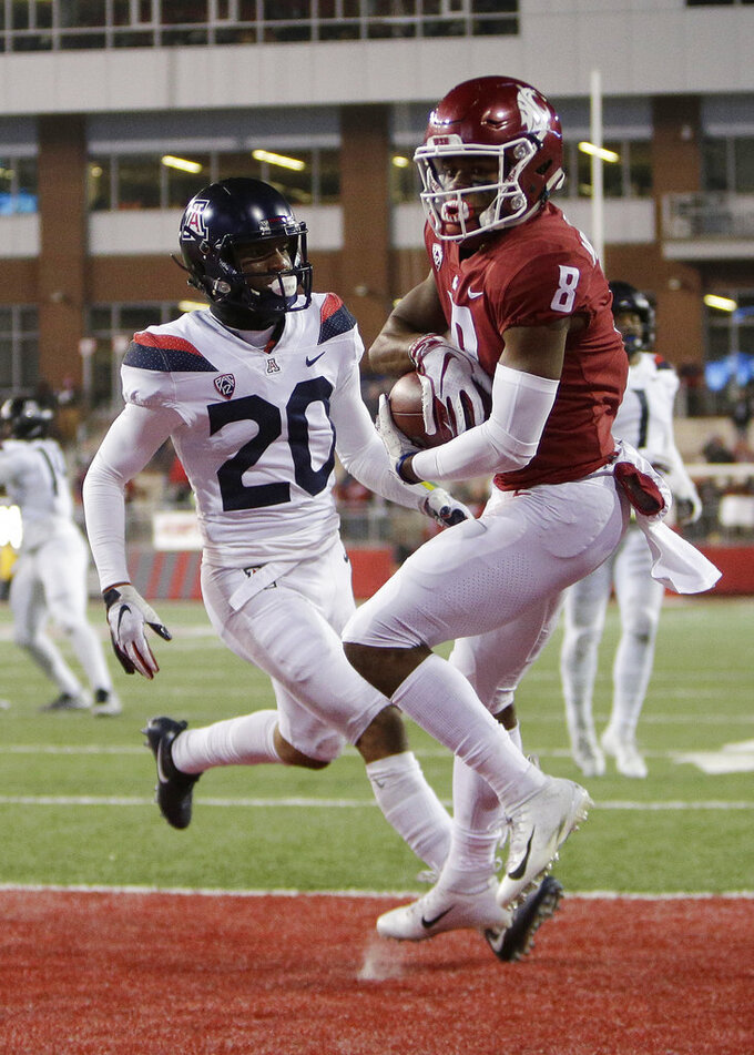 Washington State wide receiver Easop Winston Jr. (8) catches a pass for a touchdown in front of Arizona cornerback Azizi Hearn (20) during the second half of an NCAA college football game in Pullman, Wash., Saturday, Nov. 17, 2018. Washington State won 69-28. (AP Photo/Young Kwak)