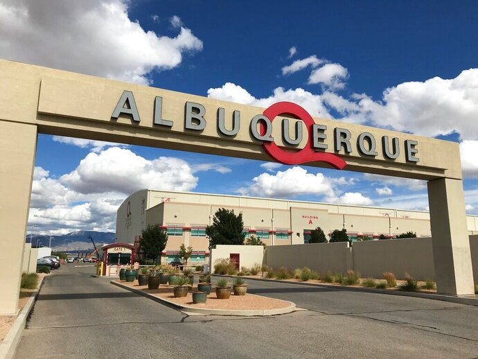 FILE - This Oct. 8, 2018, file photo shows the entrance to ABQ Studios in Albuquerque, N.M., where Netflix announced at the studio complex that it chose Albuquerque as a new production hub. An executive with Netflix says the streaming giant has boosted its original content exponentially over the last several years and that will mean more action for its production hub in New Mexico. The head of North American production policy for Netflix spoke Thursday, Dec. 5, 2019, to hundreds of business leaders who were gathered in Albuquerque, saying that Netflix alone had 1,000 projects going this year, with many based in New Mexico. (AP Photo/Susan Montoya Bryan, File)