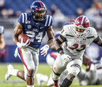 Mississippi running back Snoop Conner (24) runs past New Mexico State linebacker Rashie Hodge Jr. (23) during an NCAA college football game in Oxford, Miss., Saturday, Nov. 9, 2019. (Bruce Newman/The Oxford Eagle via AP)