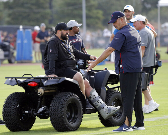 Detroit Lions coach Matt Patricia, left, talks with Houston Texans coach Bill O'Brien during an NFL football joint training camp practice Wednesday, Aug. 14, 2019, in Houston. (AP Photo/David J. Phillip)