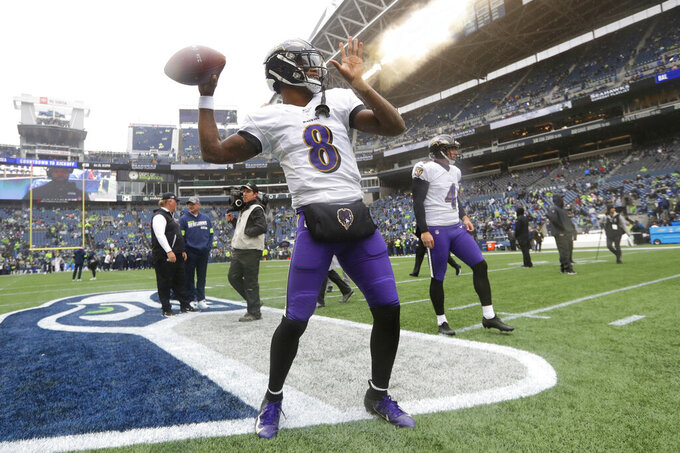 Baltimore Ravens quarterback Lamar Jackson warms up at CenturyLink Field before an NFL football game against the Seattle Seahawks, Sunday, Oct. 20, 2019, in Seattle. (AP Photo/Elaine Thompson)