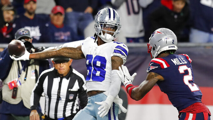 Dallas Cowboys wide receiver CeeDee Lamb (88) stretches the ball over the goal line for the game-winning touchdown, as New England Patriots cornerback Jalen Mills (2) gives chase, during overtime of an NFL football game, Sunday, Oct. 17, 2021, in Foxborough, Mass. (AP Photo/Michael Dwyer)