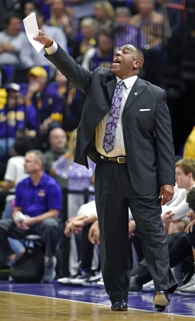Interim LSU head coach Tony Benford shouts instructions to his players in the first half of an NCAA college basketball game, Saturday, March 9, 2019, in Baton Rouge, La. (AP Photo/Bill Feig)