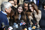 Former Illinois Gov. Rod Blagojevich's daughters Annie, center, and Amy smile during a news conference outside their home Wednesday, Feb. 19, 2020, in Chicago. On Tuesday, President Donald Trump commuted Blagojevich's 14-year prison sentence for political corruption. (AP Photo/Charles Rex Arbogast)