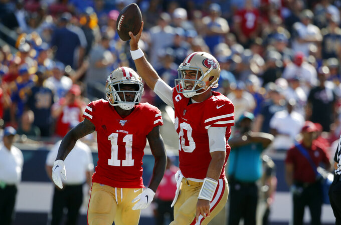 San Francisco 49ers quarterback Jimmy Garoppolo (10) celebrates after scoring a rushing touchdown against the Los Angeles Rams during the second half of an NFL football game Sunday, Oct. 13, 2019, in Los Angeles. (AP Photo/John Locher )