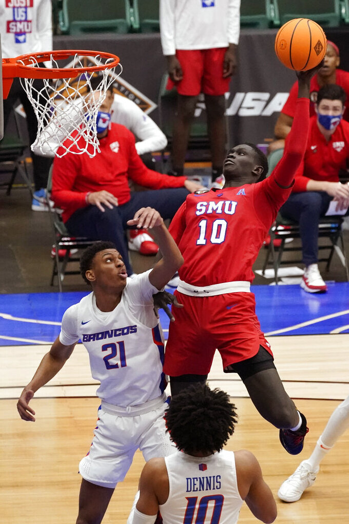 SMU forward Yor Anei (10) shoots over Boise State guard Derrick Alston Jr. (21) during the second half of an NCAA college basketball game in the first round of the NIT, Thursday, March 18, 2021, in Frisco, Texas. (AP Photo/Tony Gutierrez)