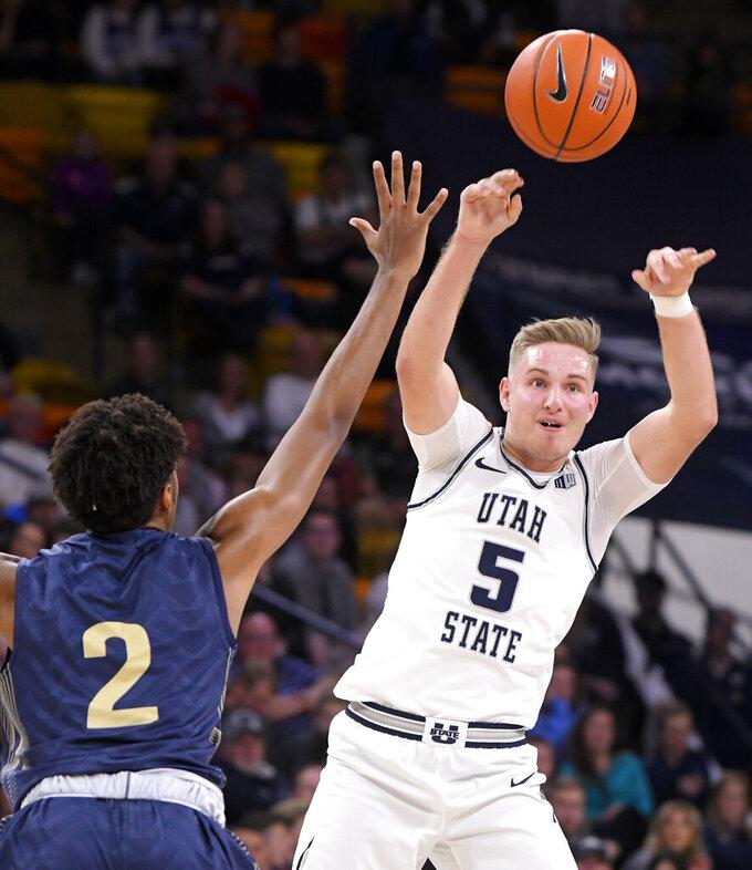 Utah State guard Sam Merrill (5) passes the ball as Montana State forward Quentin Guliford (2) defends during an NCAA college basketball game Tuesday, Nov. 5, 2019, in Logan, Utah. (Eli Lucero/The Herald Journal via AP)