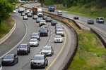 Holiday traffic travels on I-476 ahead of the Memorial Day weekend, Friday, May 28, 2021, in Springfield, Pa. (AP Photo/Matt Slocum)