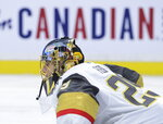 Vegas Golden Knights goaltender Marc-Andre Fleury (29) stretches during the second period of an NHL hockey game against the Ottawa Senators  Thursday, Jan. 16, 2020 in Ottawa, Ontario. (Sean Kilpatrick/The Canadian Press via AP)