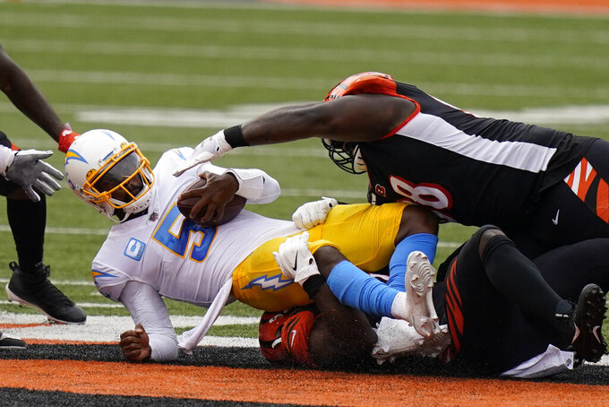 Los Angeles Chargers quarterback Tyrod Taylor (5) is sacked during the first half of an NFL football game against the Cincinnati Bengals, Sunday, Sept. 13, 2020, in Cincinnati. (AP Photo/Bryan Woolston)