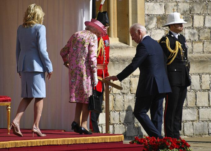 US President Joe Biden, First Lady Jill Biden and Britain's Queen Elizabeth II leave the dais after receiving Guard of Honour at Windsor Castle near London, Sunday, June 13, 2021. (AP Photo/Alberto Pezzali)