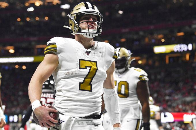 New Orleans Saints quarterback Taysom Hill (7) celebrates a touchdown against the Atlanta Falcons during the first half of an NFL football game, Thursday, Nov. 28, 2019, in Atlanta. (AP Photo/John Amis)