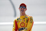 Joey Logano laughs during qualifications for a NASCAR Cup Series auto race at Michigan International Speedway in Brooklyn, Mich., Friday, Aug. 9, 2019. (AP Photo/Paul Sancya)