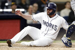San Diego Padres' Logan Allen scores from third on a throwing error by Milwaukee Brewers third baseman Mike Moustakas after San Diego Padres' Eric Hosmer lined out during the fifth inning of a baseball game Tuesday, June 18, 2019, in San Diego. (AP Photo/Gregory Bull)
