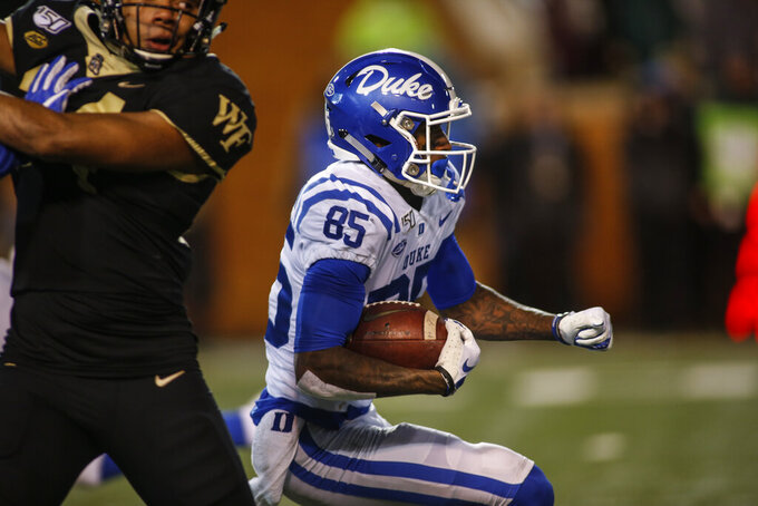Duke wide receiver Damond Philyaw-Johnson (85) finds an opening and runs back a kickoff for a 98-yard touchdown against Wake Forest in the second half of an NCAA college football game in Winston-Salem, N.C., Saturday, Nov. 23, 2019. Wake Forest won 39-27. (AP Photo/Nell Redmond)