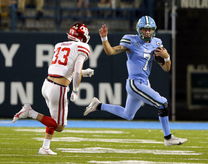Tulane quarterback Michael Pratt (7) scrambles out of the pocket during first-half play against Houston during an NCAA college football game in New Orleans, Thursday, Oct. 7, 2021. (A.J. Sisco/The Advocate via AP)