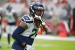 FILE - In this Sept. 29, 2019, file photo, Seattle Seahawks cornerback Shaquill Griffin (26) is shownduring an NFL football game against the Arizona Cardinals, in Glendale, Ariz. Griffin was so disappointed by his second NFL season he changed his entire offseason routine. Slimmer and faster, the Seahawks cornerback has been excellent through four games and will get another major test on Thursday against the Rams. (AP Photo/Rick Scuteri, File)