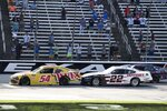 Kyle Busch (54) gets a push from Austin Cindric (22) on a restart with few laps to go in a NASCAR Xfinity Series auto race at Texas Motor Speedway in Fort Worth, Texas, Saturday, June 12, 2021. (AP Photo/Larry Papke)