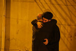 Mourners mourn outside the house of Grand Ayatollah Sayyid Mohammed Saeed al-Hakim in Najaf, Iraq, Friday, Sept. 3, 2021. Mohammed Saeed al-Hakim, one of Iraq's most senior and influential Muslim Shiite clerics, has died, members of his family said. He was 85. (AP Photo/Anmar Khalil)