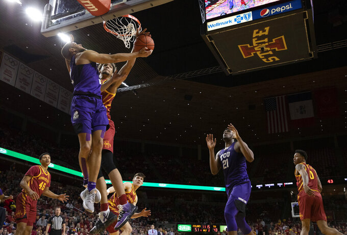 Iowa State forward George Conditt, center, blocks a shot by TCU guard Edric Dennis, left, during the second half of an NCAA college basketball game, Tuesday, Feb. 25, 2020, in Ames, Iowa. Iowa State won 65-59. (AP Photo/ Matthew Putney)