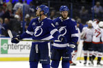 Tampa Bay Lightning center Steven Stamkos (91) and center J.T. Miller (10) leave the ice after losing 4-2 to the Washington Capitals during Game 1 of the NHL Eastern Conference finals hockey playoff series Friday, May 11, 2018, in Tampa, Fla. (AP Photo/Chris O'Meara)