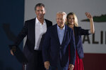 FILE — In this Sept. 13, 2021, file photo President Joe Biden, center, smiles to the crowd as he is flanked by California Gov. Gavin Newsom and Jennifer Siebel Newsom at a rally ahead of the California gubernatorial recall election in Long Beach, Calif. In the recall election, Newsom won big in coastal urban areas such as Los Angeles County, while the pro-recall side performed better in California's Central Valley and northern areas. (AP Photo/Jae C. Hong, File)